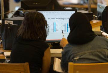 students studying in front of a computer