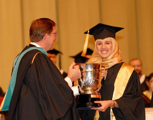 student receiving her certificate during graduation ceremony