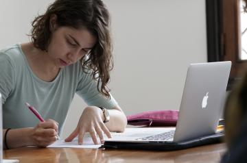 girl studying on a computer